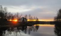 Solnedgång bortom Herrgården